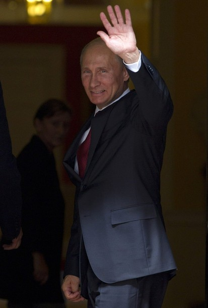 Russian President Vladimir Putin waves as he meets Prime Minister David Cameron at Downing Street in London